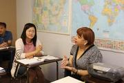 Tampa Language Center Director and teacher  Eva Velez sits in on an english class and Soyoung Lee from South Korea listens to Valez talk about business practice in the USA and other countries.