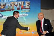 Justin Meyer, director of Air Service Development for TIA, prepares to fist-bump Tampa International Airport CEO Joe Lopano.