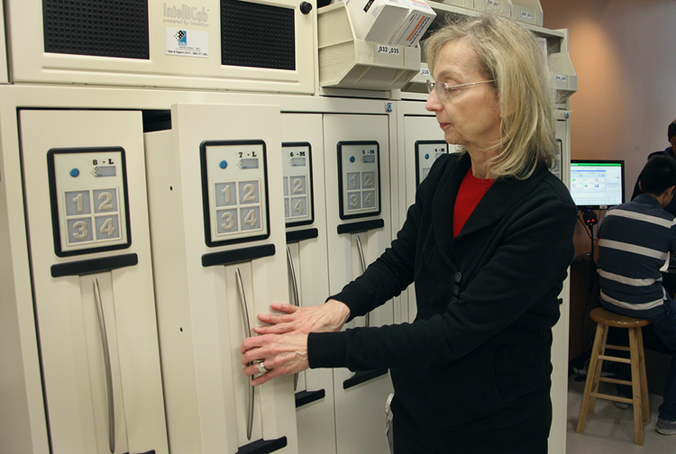 Sandy Anderson, Old Town Clinic's head pharmacist, retrieves a prescription using the IntelliCab system.