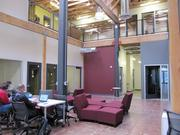 Impact Hub Oakland is a co-working community that features private offices and open seating areas for members.