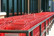 Red shopping carts prepped for customers at Trader Joe's under construction in South Tampa.