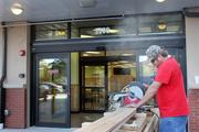 Trader Joe's under construction on Swann Avenue in Tampa. A workman cuts cedar for the inside of the store.