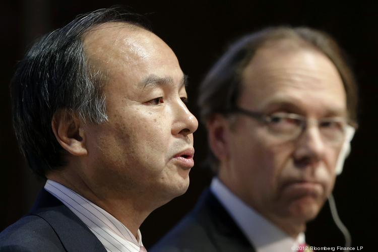 Softbank CEO Masayoshi Son (left) speaks as Sprint CEO Dan Hesse listens during a news conference in Tokyo.