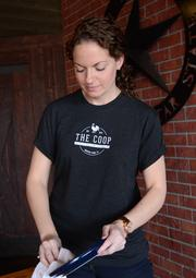 Courtney Paster of 4R Restaurant Group sports the employee uniform shirt from The Coop during a tasting event at 4 Rivers Smokehouse WInter Park location.