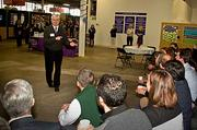 Paul Guzzi, president and CEO of the Greater Boston Chamber of Commerce makes a couple of points to the 75 local business executives who volunteered at the Cradles to Crayons President's Day Celebration of Service. The Chamber along with The Boston Business Journal sponsored the event.