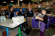 Amanda Role, a group volunteer leader explains what needs to be done to some of the 85 local business executives who volunteered at the Cradles to Crayons President's Day Celebration of Service.