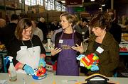Cradles to Crayons CEO and founder Lynn Margherio (center) was all business with  Cradles to Crayons President's Day Celebration of Service volunteers Siohan Dullea (left) of Communispace and Mary McGeown from the Massachusetts Society for the Prevention of Crulelty to Children.