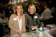 The Castle Groups Sandy Lish and Sharon McNally of Connors Family Office pitched in by cleaning toys at the Cradles to Crayons President's Day Celebration of Service.