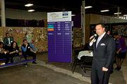 Boston Business Journal publisher Chris McIntosh announces the results of the corporate volunteers who volunteered at the Cradles to Crayons President's Day Celebration of Service. The BBJ along with the Greater Boston Chamber of Commerce sponsored the event.