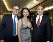 Axis Energy Partners region director Greg Schmidt, PG&E program director Rosa Escutia-Braaton and Econergy Inc. founder Jaspal Deol pose at the Sacramento Hispanic Chamber of Commerce awards.