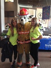 Education: Small companies Schumacher & Associates  Paraplanner Jessica Roma (left) volunteering at Battle of the Badges: Climb for a Cure benefitting Cystic Fibrosis Foundation.  At a glance: Volunteers: 3 Top charitable cause: Fighting human trafficking.