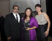Sacramento Hispanic Chamber of Commerce board chairman Marcus Gomez, Big S Design owner Silvia Alejandra Leyva and Chamber CEO Alice Perez pose at the Chamber's awards. Big S won the Small Business of the Year award.
