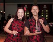"Asian Resources executive director Stephanie Nguyen and professional dance instructor Gerardo Martinez pose with their awards for winning the ""Latin Dancing with the Stars"" contest at the Sacramento Hispanic Chamber of Commerce awards gala."