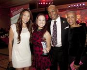 Asian Resources executive assistant Thyan Pham, Asian Resources executive director Stephanie Nguyen, Citrus Heights Mayor Mel Turner and wife Connie Turner pose at the Sacramento Hispanic Chamber of Commerce awards.