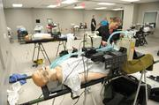 The simulation center can be set up like a surgical operating room, or the inside of an ambulance or a helicopter used to transport critically injured patient.