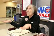Suzanne Davis, a No Toll on I-90 volunteer and a resident of Mercer Island for 42 years, answers questions about the issue at an October public meeting.