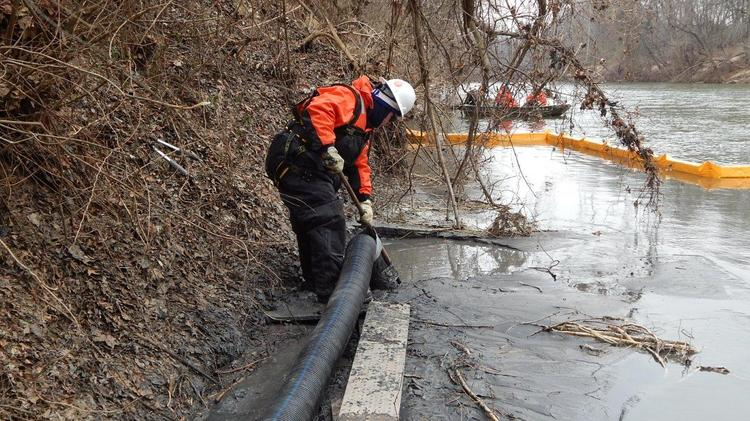 Duke Energy crews vacuumed coal ash out of the Dan River in March in an early effort to clean up after the massive spill in February.