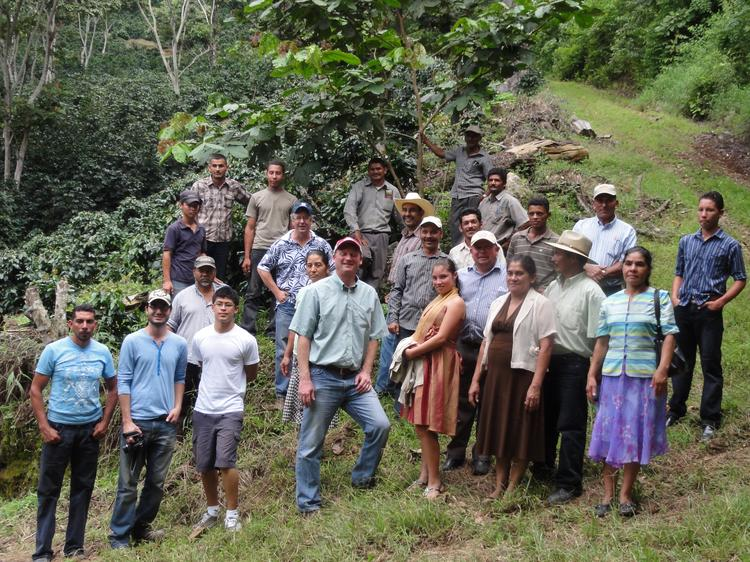 Crimson Cup founder Greg Ubert, center, visited a coffee plantation in Honduras to build a relationship with the farmers there.