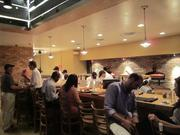 Diners can choose to sit at a bar in front of the open kitchen at the Merrifield location.