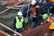Crews work at a construction site in South Lake Union where a mammoth tusk was found. The tusk was discovered Tuesday night on land owned by a commercial real estate developer.