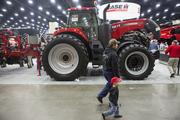 Two boys walked by the Case tractor section at the Kentucky Exposition Center.