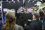 Some attendees checked out cow silhouettes for sale at the show.
