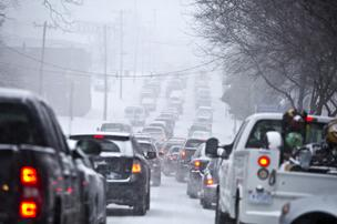Cars come to a complete stand still along Dawson street, Raleigh, during the afternoon snowstorm on Feb. 12.