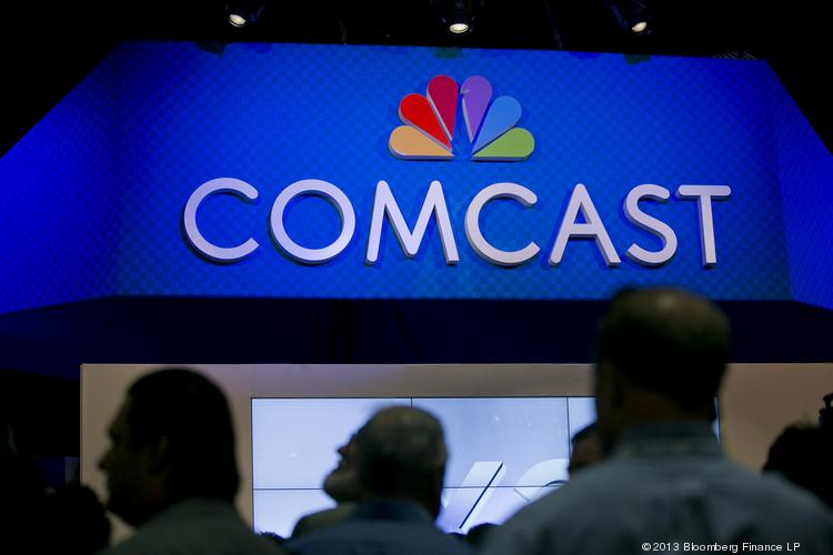 The Comcast Corp. logo is seen on the exhibit floor at the National Cable and Telecommunications Association (NCTA) Cable Show in Washington, D.C.