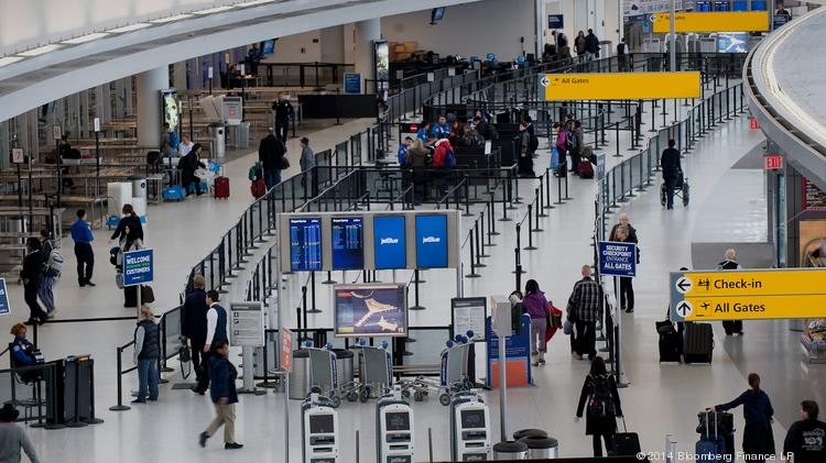 Travelers check in for JetBlue Airways flights at John F. Kennedy International Airport in New York. JFK was the closest airport to land on any of SKYTRAX's 2014 top 10 lists.