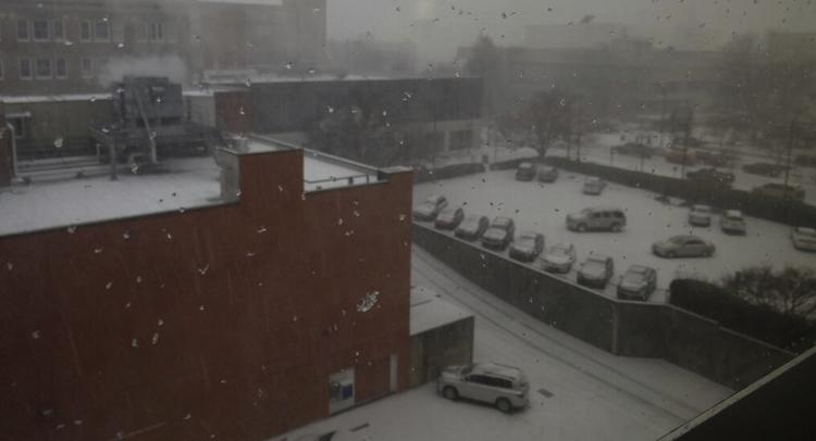 Snow began in downtown Greensboro about 1 p.m. Wednesday and quickly started to stick.