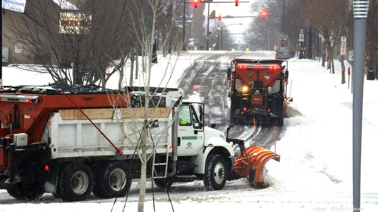 Crews worked through the night on clearing Charlotte roads as a storm continued to dump wintry precipitation on the area.