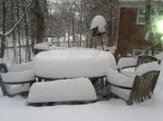 Snow piles up in the backyard of Abe Novick's home in Towson.