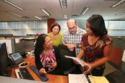 DTCC's Tampa office is a full business center, with an underwriting department that evaluates internal business standards. From left, Yvette Smith, specialist, Nellie Flecha, specialist, Anthony Rohr, lead specialist and Tracy Barnes, team lead.