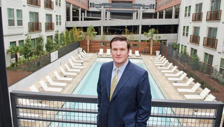 """Jones Lang LaSalle Vice President Forshey Hoobler is among the growing number of apartment dwellers in Uptown. """"The energy from the area of young professionals is motivating,"""" he says."""