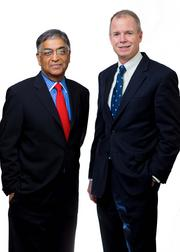 Raj Gupta (left) of the former Rohm and Haas with CEO George Oliver of Tyco International.