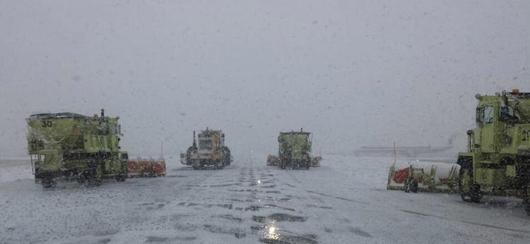 Crews work to clear snow Wednesday at Piedmont Triad International Airport in Greensboro.
