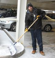 Jeff Hall of the Wake Forest Baptist Medical Center's engineering department shovels snow Wednesday afternoon at the School of Medicine.