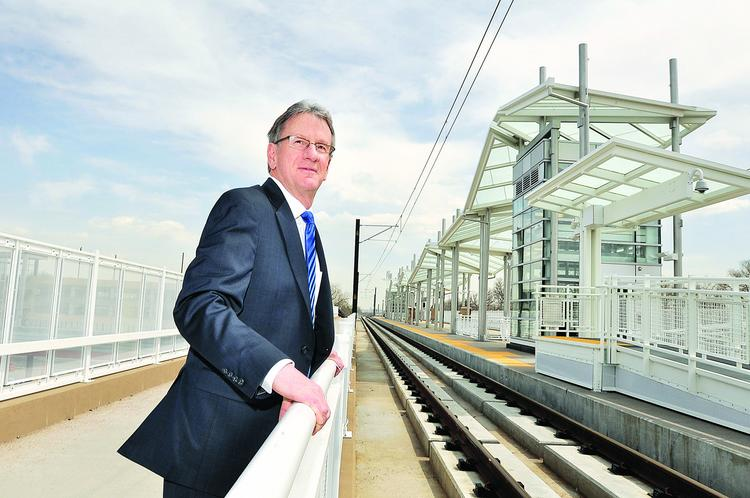 """Lakewood Mayor Bob Murphy, watching for the test train at the Lakewood - Wadsworth Station, says, """"This train gives people and businesses a new opportunity and a new way to come to Lakewood."""""""