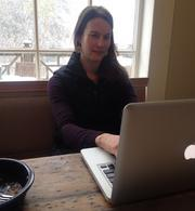 Kim Martin, an account director at Pace Communications in Greensboro, was hard at work Wednesday afternoon at her home in Fisher Park as the snow got started.