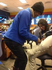 At WXII's offices in Winston-Salem, Margaret Johnson helps Veronica White get bundled up for snow coverage.