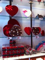 Traditional heart-shaped boxes of chocolates by Edward Marc Chocolatier line the walls at the Milk Shake Factory.