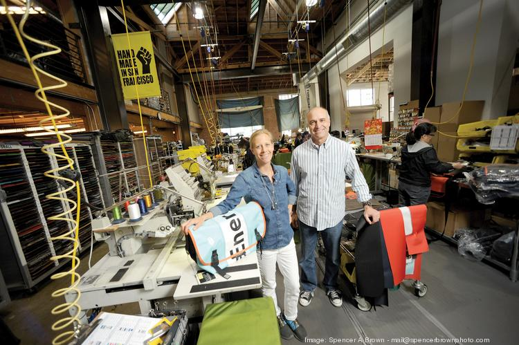"""""""Made in S.F"""" is more than a label, says Timbuk2's Brand Director Lizzy Fallows, left, with COO Tony Meneghetti. But some of its lower-cost lines are now made in China."""
