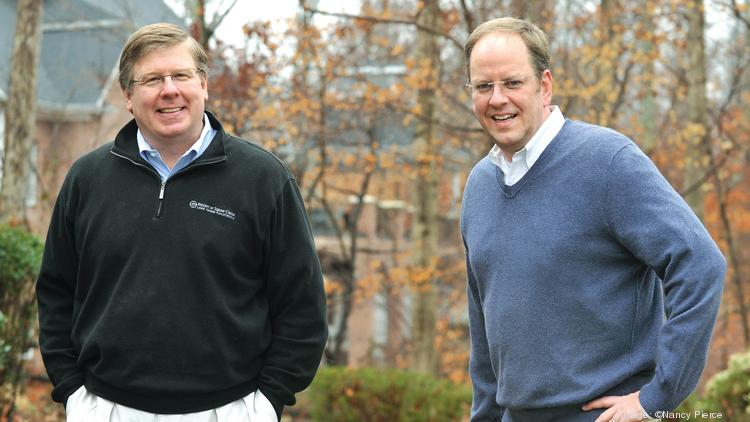 Paul Yoder, left, and Mike Ladd recently sold their company, EnablePath, to Birlasoft of New Delhi.