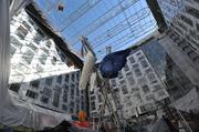 """Shown here in September, the 56-foot """"Birth of the American Flag"""" sculpture by Rodney Carroll will be the focal point of the Marquis atrium and lobby bar."""