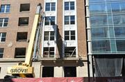 """Shown here in September 2013, the spot where the former """"Plumbers Building"""" facade meets the new hotel."""
