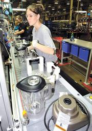 DBJ photo by James E. Mahan Michelle Jennings works on the blender assembly line at the Kitchen Aid factory in Greenville, Ohio.
