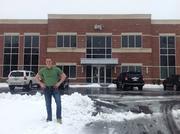 Mason Barringer, an accounting intern at Davenport, Marvin Joyce & Co. LLP, stands outside their Greensboro offices. Not only did DMJ not let the snow slow them down for their busy season, but Barringer was outside in a t-shirt toughening up for DMJ's 14th Polar Plunge for Special Olympics NC on Feb. 22.