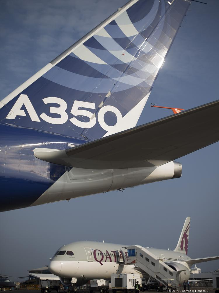An Airbus SAS A350 XWB flight test aircraft (MSN3), left, on display at the Singapore Airshow in February.