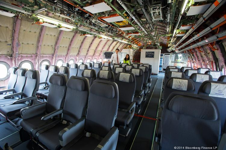 The interior of the Airbus SAS A350 XWB flight test aircraft (MSN3), which does not include any passenger cabin facilities, is displayed during a media preview at the Singapore Airshow held at the Changi Exhibition Centre in Singapore on Feb. 10.
