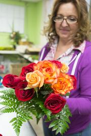 Susan Hart of Anything with Plants prepares bouquets for Valentine's Day delivery.